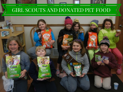 GIRL SCOUTS AND DONATED PET FOOD